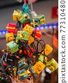 Christmas gift boxes and lights on display 77310480