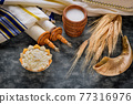 Torah and kippah on celebration Jewish Holiday Shavuot for Kosher dairy product 77316976