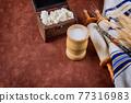 Symbols of jewish holiday Shavuot torah and shofar old red background. 77316983