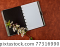 Office desk top view with pencil and notebook on red background 77316990