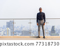 Full length shot of handsome African businessman outdoors at rooftop 77318730
