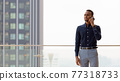 Portrait of handsome African businessman outdoors at rooftop 77318733