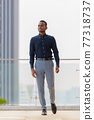 Full length shot of handsome African businessman outdoors at rooftop walking 77318737