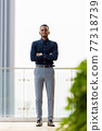 Full length shot of confident African businessman outdoors at rooftop 77318739