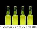 Row of beer bottles ona black background 77320308