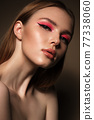 Portrait of a beautiful woman with pink creative make up. Beauty face 77338060
