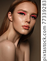 Portrait of a beautiful woman with pink creative make up. Beauty face 77339283