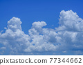 blue sky background with clouds. Beautiful white clouds against the blue sky. 77344662