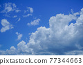 blue sky background with clouds. Beautiful white clouds against the blue sky. 77344663
