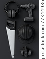 Top view of monochrome construction tools for repair and installation on black 77344986