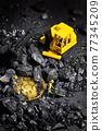 Galati, Romania - April 27, 2021 Construction site with miniature workers mining Bitcoin 77345209