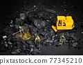 Galati, Romania - April 27, 2021 Construction site with miniature workers mining Bitcoin 77345210