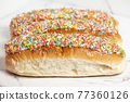 Iced finger buns with sprinkles 77360126