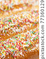 Iced finger buns with sprinkles 77360129