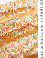 Iced finger buns with sprinkles 77360130