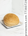 Wholemeal bread roll 77360729