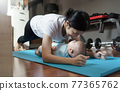 Asian young mother doing plank exercise with her baby boy at home. 77365762