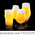 Set of fresh light beer glasses with bubble froth isolated on black background. 77372374
