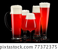 Set of fresh stout beer glasses with bubble froth isolated on black background. 77372375