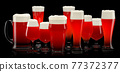 Set of fresh stout beer glasses with bubble froth isolated on black background. 77372377