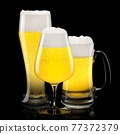 Set of fresh light beer glasses with bubble froth isolated on black background. 77372379