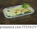 Baked Spinach with Cheese in Foil tray Italian Style 77374177