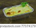 Baked Mashed Potatoes with Cheese in Foil tray 77374179