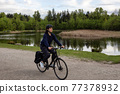 Adventure Woman Bike Riding in a Park 77378932