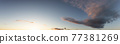 Panoramic View of Cloudscape with puffy sky and clear sunny sunlight 77381269