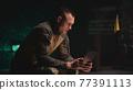 Military man making video call in dark gym 77391113