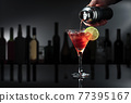 """Cocktail """"Barbados"""" on a black table in a bar. 77395167"""