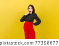 Young surprise or shocked woman pregnant isolated colored background. expression female 77398677