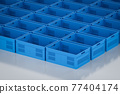 group of blue plastic crates 77404174