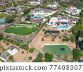 Aerial view off massive expensive mansions in the valley of Carlsbad, North County San Diego 77408907