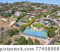 Aerial view off massive expensive mansions in the valley of Carlsbad, North County San Diego 77408908
