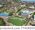 Aerial view off massive expensive mansions in the valley of Carlsbad, North County San Diego 77408909
