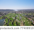 Aerial top view of a golf course in Carlsbad 77408910