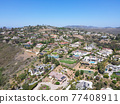Aerial view off massive expensive mansions in the valley of Carlsbad, North County San Diego 77408911