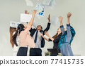 Business people throwing papers in the office. 77415735