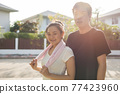 smiling Asian couple portrait after exercising 77423960