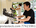Happy young Asian couple work out in gym 77423961