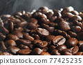 Hot roasted coffee beans 77425235