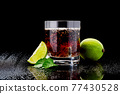 Whiskey with steel cooling cubes on dark glass background 77430528