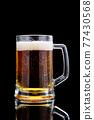 Studio shoy of Mug with beer on dark background 77430568