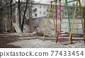 Photo of abandoned dirty street with playground 77433454