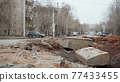 Photo of abandoned dirty street with digged pit 77433455