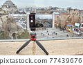Tripod with smartphone holder as vlogging equipment. 77439676