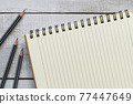 Top view of blank notebook and pencils on white wood table with copy space for business and education concept 77447649