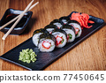 Sushi on a Wooden Table in Restaurant, Delicious Japanese Food, Sushi Rolls 77450645