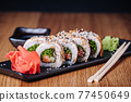 Sushi on a Wooden Table in Restaurant, Delicious Japanese Food, Sushi Rolls 77450649